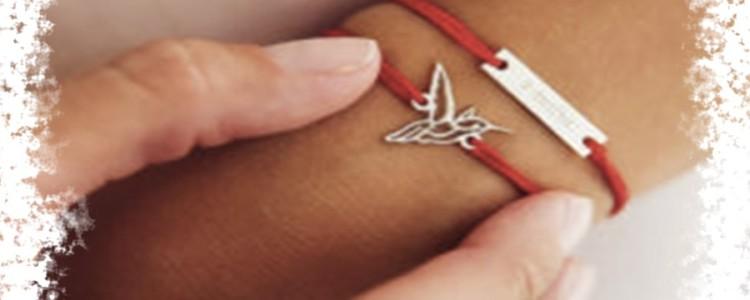 Красная нить на запястье — как завязать правильно