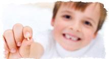 Поверья о первом выпавшем молочном зубе